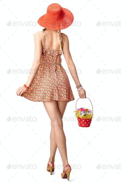 Beauty boho woman in sundress with basket, summer