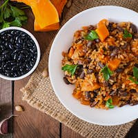 Mexican vegan vegetable pilaf with haricot beans and pumpkin