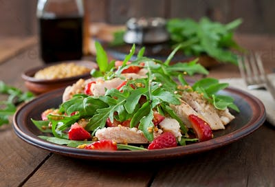 Chicken salad with arugula and strawberries