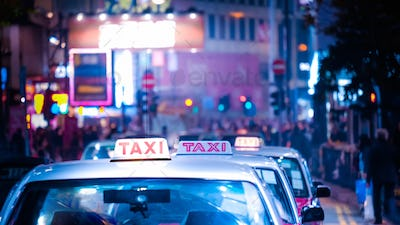 Hong Kong cityscape with taxi car at night city street