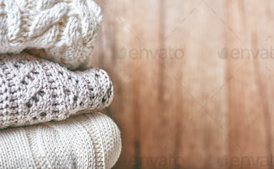 stack of knitting clothes