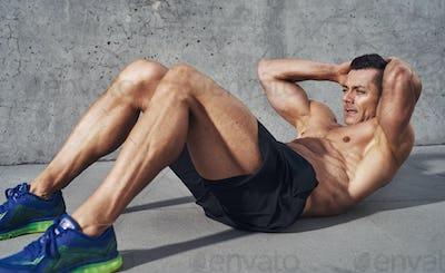 Muscular man exercising doing