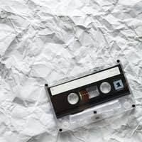 Audio cassette is lying on the paper
