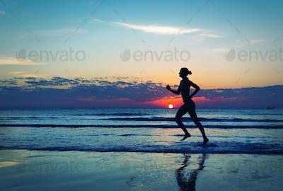 Girl runing  along the sea coast