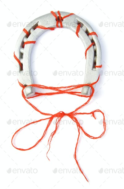 Horseshoe with red thread