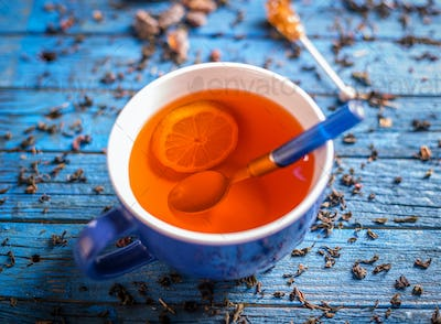Cup with fresh herbal tea