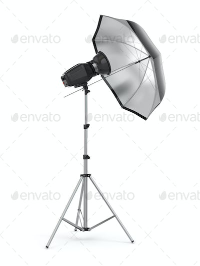 Studio strobe light flash with umbrella.