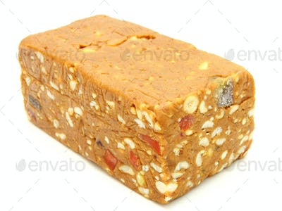 Peanut butterscotch fudge on a plate isolated on white
