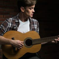 Man playing on the guitar