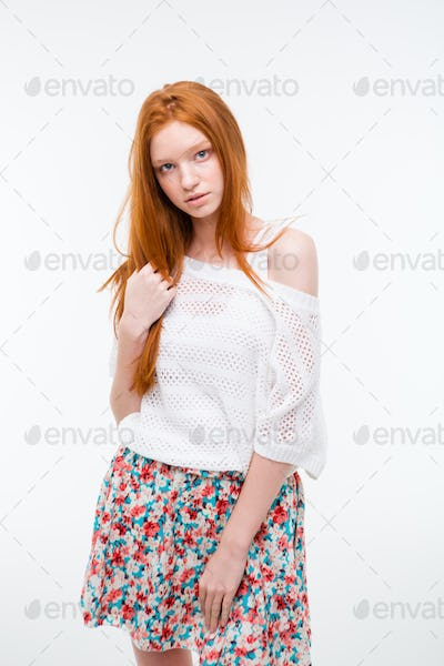 Sensual attractive young female with beautiful long red hair