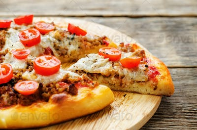 pizza with meat, mozzarella and tomatoes