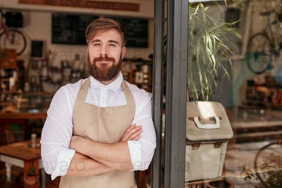 Handsome and confident cafe owner