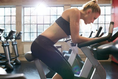 Young woman resting after workout in gym