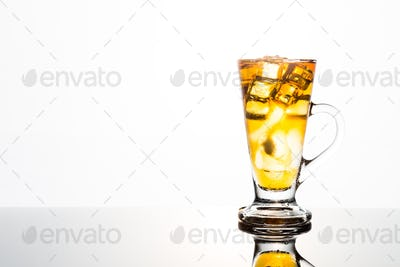 Refreshing iced tea in tall glass