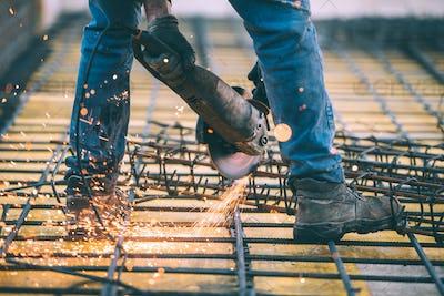 Industrial construction engineer cutting steel