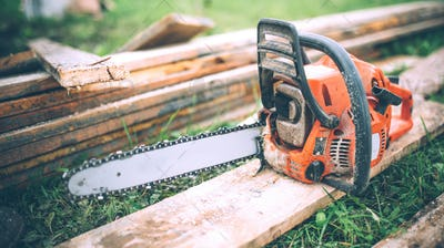 close-up view of chainsaw, construction tools, agriculture details. Gardening equipment
