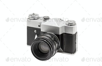 Old film camera with lens, isolated on white background