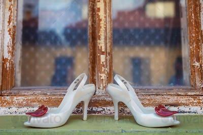 Bridal shoes on window parapet