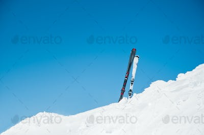 Image of skis on slope, on winter resort