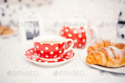 Delicious and tasty fresh coffee or tea cup and croissants as snack
