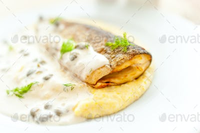 main course - mashed potatoes with fried fish and white sauce