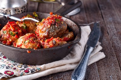 meatballs with tomato sauce in black pan