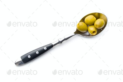 pitted green olives in spoon
