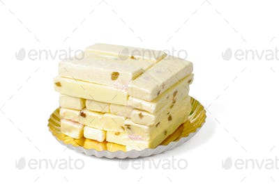 bars of white fudge stacked on plate