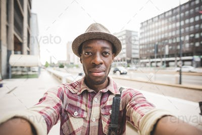 Half length of young handsome afro black man taking a selfie, lo