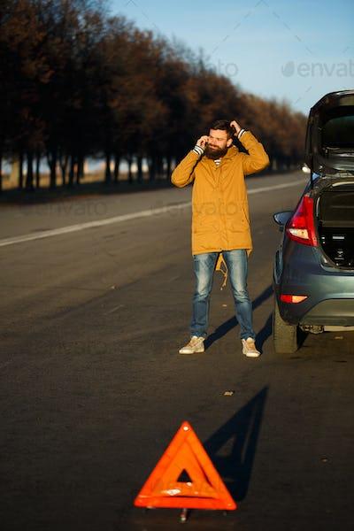 Driver man examining damaged automobile cars