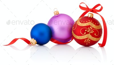 Three colored Christmas baubles with ribbon bow isolated on whit