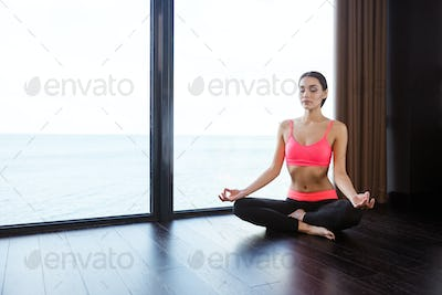 Fitness woman meditating in gym