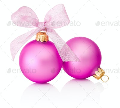 Two pink Christmas baubles with ribbon bow Isolated on white bac