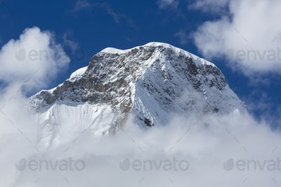 Snow covered mountain peak and blue sky, Cordillera Blanca, Peru