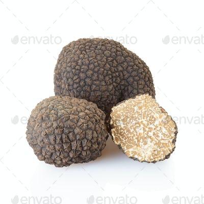 Black truffles and half on white