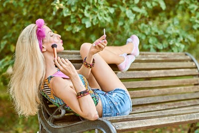 Beauty woman primping in park, lifestyle, people