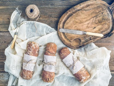 Freshly baked rustic village bread (baguettes) wrapped in paper