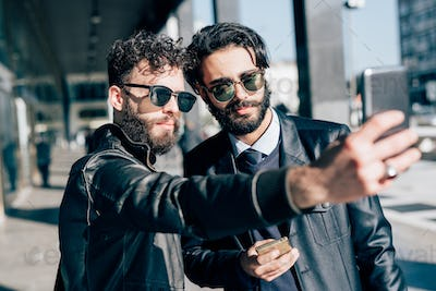 bearded brown hair businessmen taking a selfie