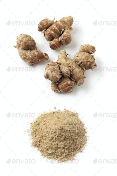 Fresh kencur roots and ground kencur powder