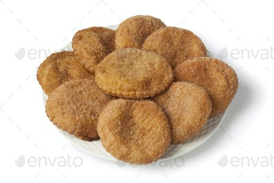 Heap of sugared fried apple fritters or appelflappen
