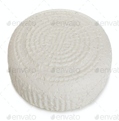 Wheel of traditional fresh cottage cheese close-up isolated on a white background.