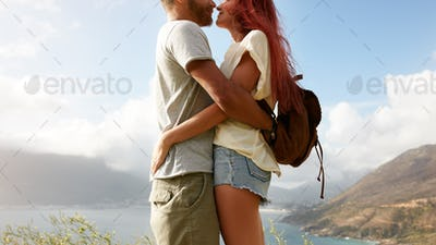Romantic couple embracing outdoors