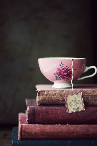 Vintage teacup on stack of old books