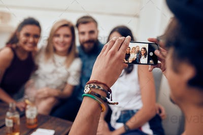 Man photographing his friends at party