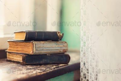 Old books on windowsill