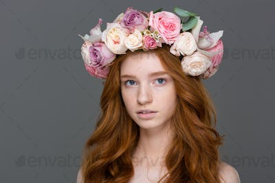 Portrait of sensual young woman with long hair in wreath