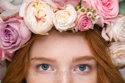 Closeup of beautiful woman eyes in flower wreath