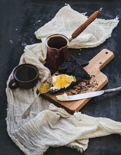 Breakfast set. Coffe, black toasts with cream-cheese and orange marmalade