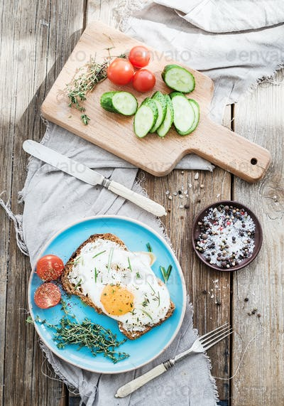 Breakfast set. Whole grain andwich with fried egg, vegetables and herbs