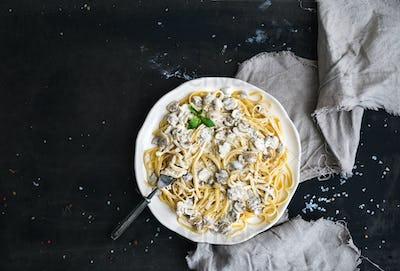 Pasta spaghetti with creamy mushroom sauce and basil
